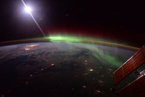 Calgary, CanadaMoonlight reflected in the ISS solar panels as an aurora dances over northern Canada.