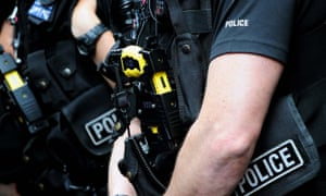 Police officers carrying Tasers