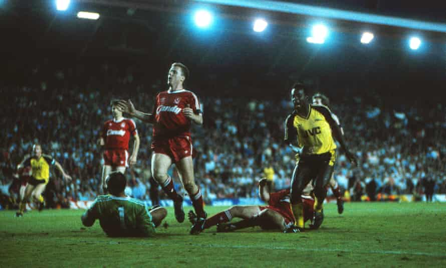 It's up for grabs now: Michael Thomas wheels away after scoring the improbable injury-time goal that saw Arsenal win 2-0 at Anfield, and take the title off Liverpool in 1989.