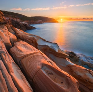 Sunrise over the tessellated pavement in Bouddi National Park.