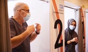 Pharmacists Peter Marks and Rohina Arshad at work at the vaccination centre