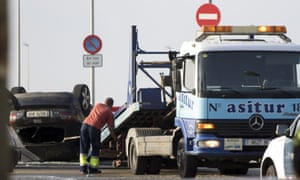 A flatbed truck removes the car suspected of being used in the terror attack in Cambrils.