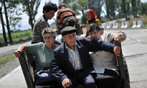 Georgians flee on a tractor in South Ossetia near the village of Troiavi in August, 2008.