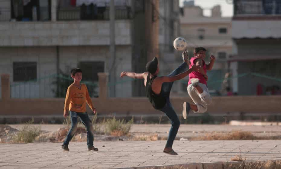 Boys play soccer in Manbij, Syria, where the Syrian Democratic Forces have mostly taken control of the city from Islamic State.