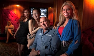Dennis Hof, center, owner of the Moonlite Bunny Ranch, a legal brothel in Nevada.