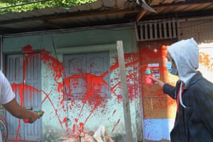Protesters throw red paint