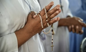 A nun prays at a mass for the victims of the blast at St Sebastian's church in Negombo, Sri Lanka