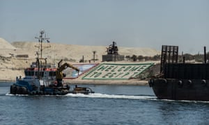 Boats cross through the new Suez canal in Ismailia, Egypt. Officials predict a more than twofold increase in revenues for the canal, from $5.3bn to $13.2bn in 2023.