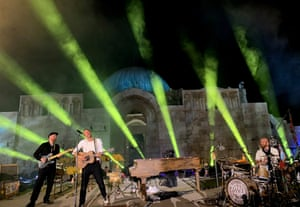 Coldplay frontman Chris Martin (C), drummer Will Champion (R) and guitarist Jonny Buckland (L) perform at the Citadel, launching their new album, Everyday Life