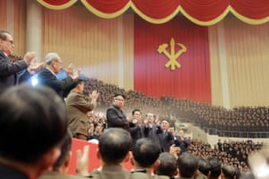 Leader Kim Jong-un applauds after a performance by the Moranbong Band and the country's State Merited Chorus at the first conference of leaders from the primary committees of the Workers' Party of Korea