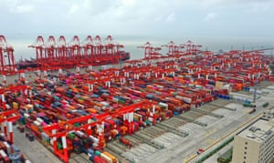 Stacks of containers in a container terminal at the Yangshan Deepwater Port in Shanghai, China.