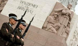 Guards in front of the freedom monument in Riga, Latvia