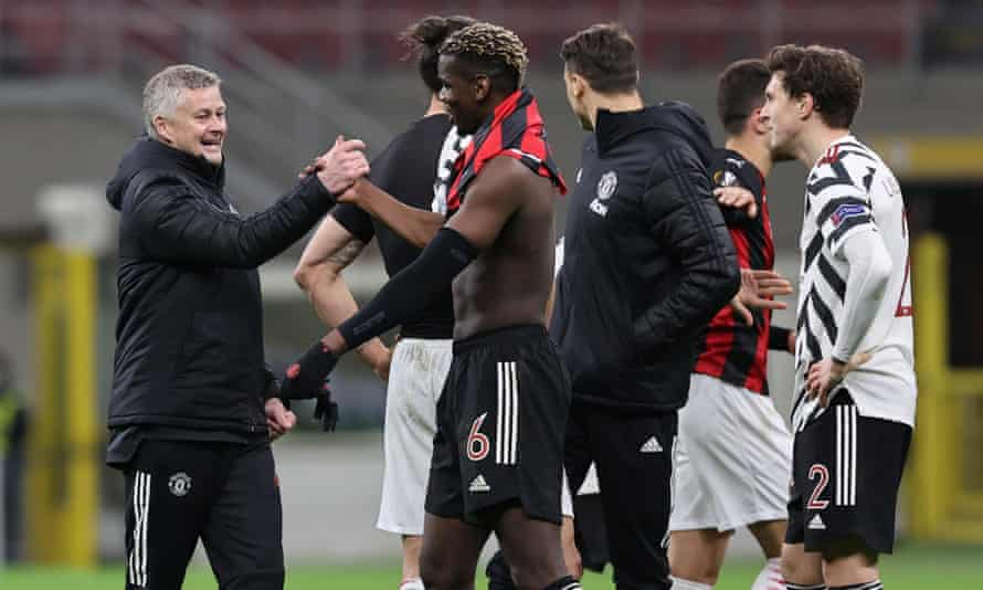 Ole Gunnar Solskjær greets Paul Pogba after Thursday's win in Milan.