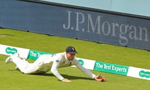 Jos Buttler stops the ball from going to the boundary.