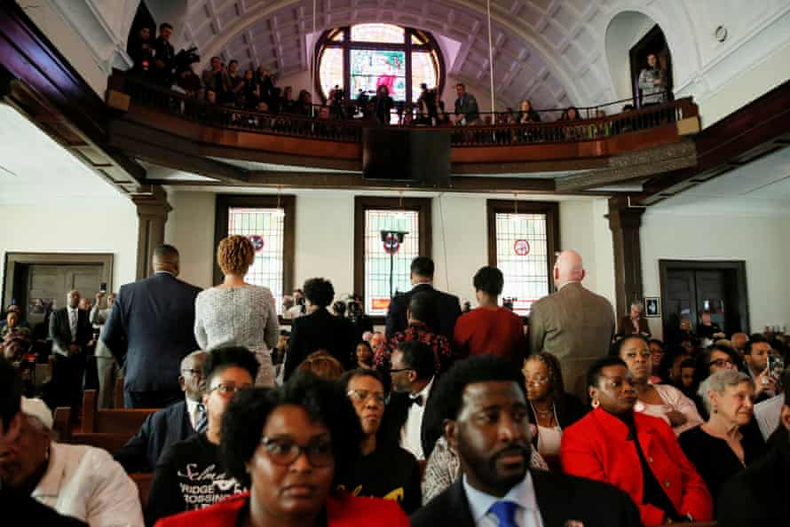 Attendees stand and turn their backs on Mike Bloomberg during a commemoration ceremony for the Bloody Sunday march in the Brown Chapel AME Church in Selma, Alabama, Sunday.