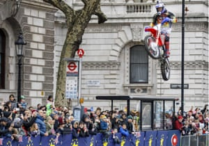 A motorbike stunt is being performed at the annual New Year's Day Parade in central London