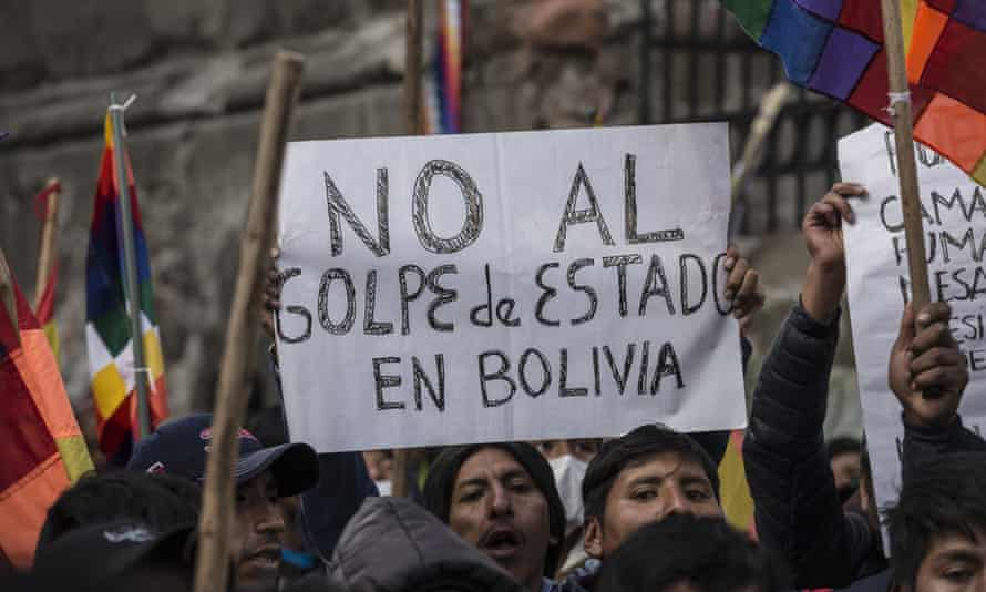 Evo Morales supporters protest in La Paz<br>LA PAZ, BOLIVIA - NOVEMBER 12 : A supporter of former President Evo Morales holds a banner during a protest in La Paz, Bolivia, on November 12, 2019. Protesters have been in the streets calling for Morales' resignation. He stepped down after the army requested he leave his post and requested political asylum from Mexico. (Photo by Marcelo Perez Del Carpio/Anadolu Agency via Getty Images)