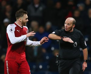 Mike Dean tries to explain to Calum Chambers why he gave a penalty for handball.