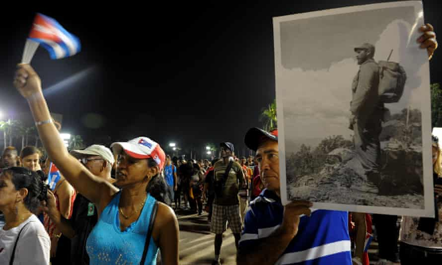 People pay homage to the late Cuban leader Fidel Castro on Saturday night during the last ceremony before his burial in Santiago.