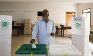 A man casts his ballot at a polling station during general election in Karachi.