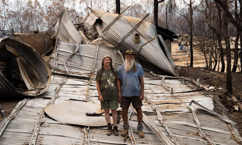 Patto and Gino McDonald with wrecked house.