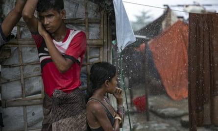 Rohingya refugees during a rainstorm at the Nayapara refugee camp in Cox's Bazar, Bangladesh