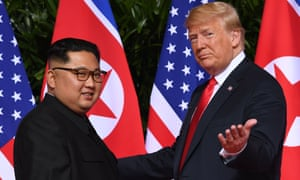 Donald Trump and Kim Jong-un at the start of their summit.