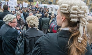 Lawyers stage a protest against legal aid cuts