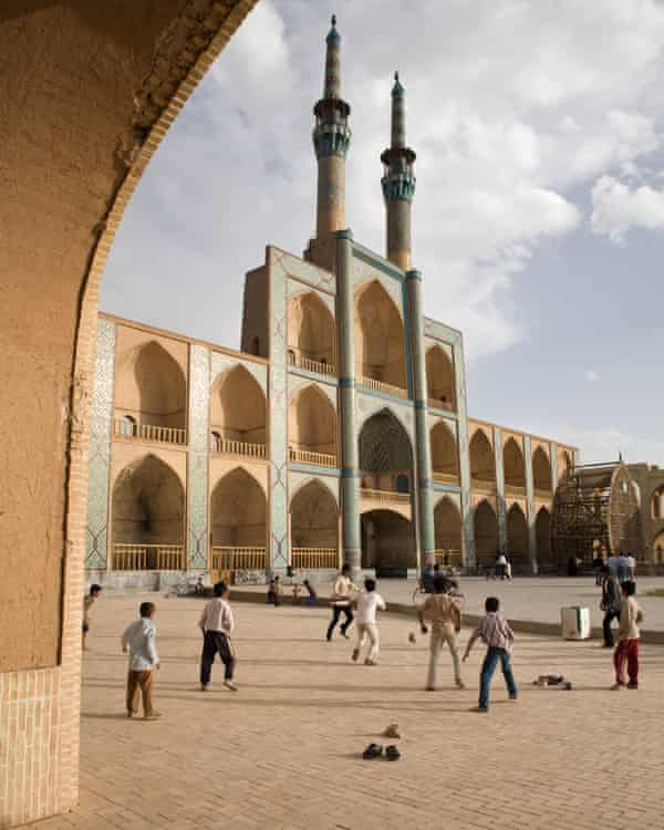 A game of street football takes place in front of Takyeh Amir Chakhmagh in Yazd, Iran in 2007.
