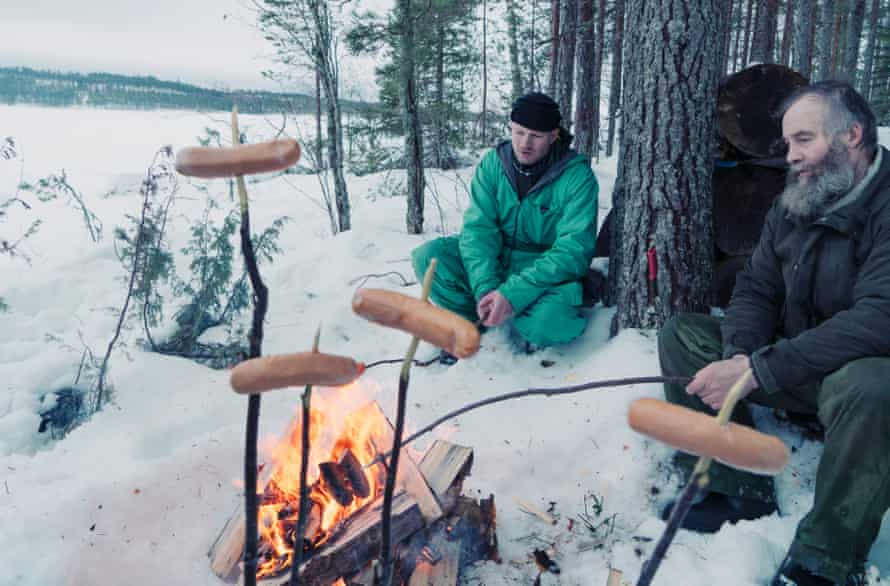 Wolf  trackers stop for lunch in the forest around Lieksa, Finland