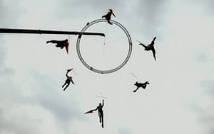Dancers practise for a performance tied to a crane in preparation for a Christmas play in Bogota