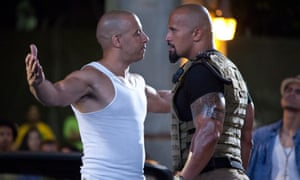 'Give us a cuddle': Vin Diesel and Dwayne 'the Rock' Johnson in happier times on Fast and Furious 5.