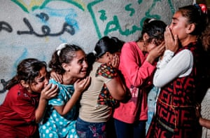 Young relatives of 28-year-old Alaa Hamdan, killed by Israeli fire during clashes along the Gaza border, mourn at his funeral in Beit Hanoun.