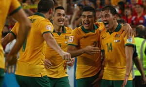 James Troisi celebrates with his teammates after hitting the Socceroos' second goal.