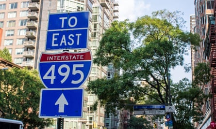 Traffic street sign with directions to the Interstate 495 exit