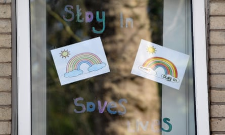 Rainbow posters in care home window