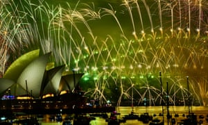 Fireworks explode over the Sydney Harbour Bridge and Sydney Opera House during the midnight display.