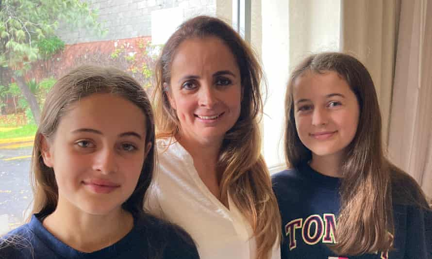 Claudia Rattray, 44, and her daughters, Ivanna, 15, and Summer, 14, in their hotel room in Mexico City.