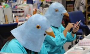 people dressed up with Twitter bird heads