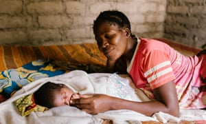 Eva Paulo with her baby daughter, Neema Nkwaya, one day old, at home. Without a clean water source the baby remains at high risk of infection