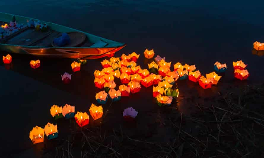 Candles being launched onto a river.
