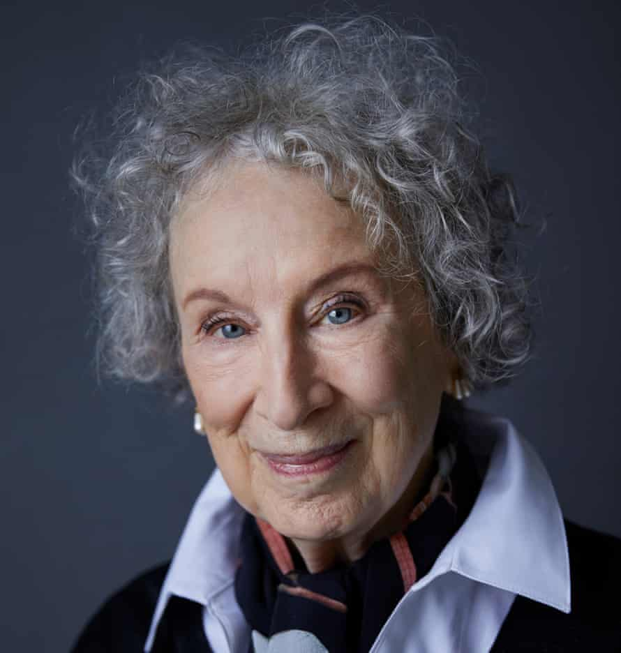 Headshot of Margaret Atwood against blue-grey background