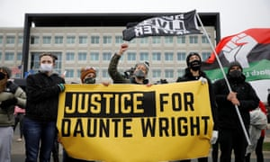 Demonstrators march after Daunte Wright was shot and killed by former BCPD Officer Kim Potter, in Brooklyn Center, Minnesota, on Sunday.