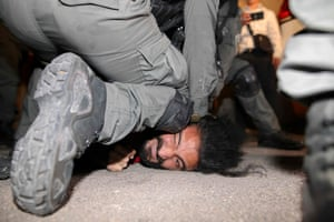 Sheikh Jarrah, Jerusalem. Israeli security forces detain a Palestinian man amid ongoing confrontations. Palestinian families face eviction from the area