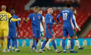 The England players, including Jude Bellingham and Phil Foden, celebrate their win after the final whistle.