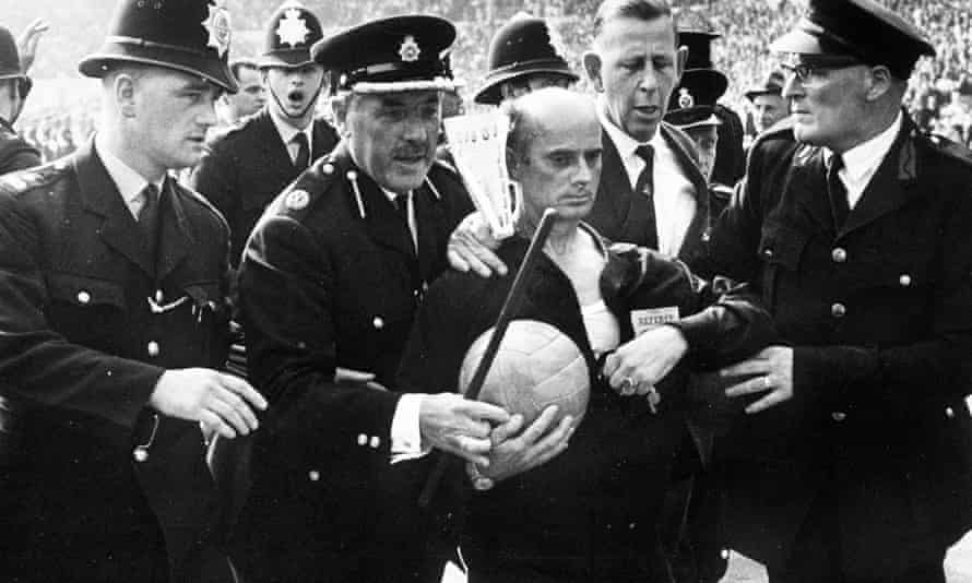 World Cup quarter-final, 1966, Wembley Stadium, German referee Kreitlin is escorted off the pitch by police