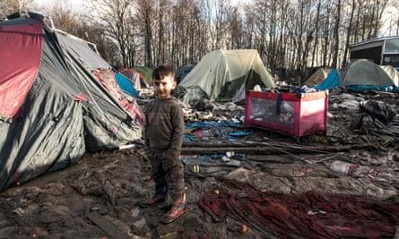 A five-year-old Kurdish boy from Iraq at a camp near Dunkirk, northern France