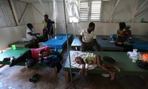 People with cholera symptoms receive medical care in Saint Antoine hospital in Jérémie on Thursday.