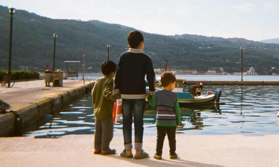 Boys from the Samos camp look out to sea.