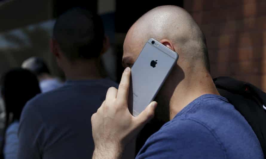 A person talks on his Apple iPhone